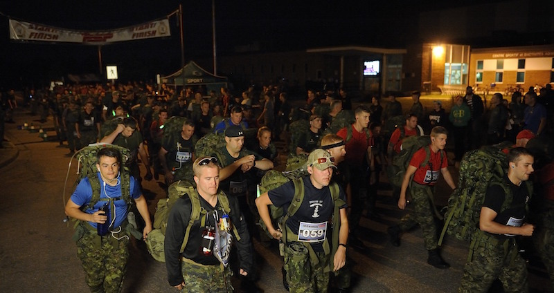Participants of the 31st annual 2 Canadian Mechanized Brigade Group (2 CMBG) Ironman Competition begins the race at 4:00 AM on September 10th 2014 at Garrison Petawawa, Ontario. Photo by Sgt Jean-Francois Lauzé, Garrison Imaging Petawawa PA2014-0184-01