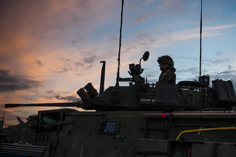 A member of the multinational brigade from 5 Canadian Mechanized Brigade-Group sits in the turret of a Light Armoured Vehicle III, in Santa Margarida, Portugal, during JOINTEX 15 as part of NATO's exercise Trident Juncture 15 on October 30, 2015. Photo: Sgt Sebastien Frechette VL06-2015-382-16