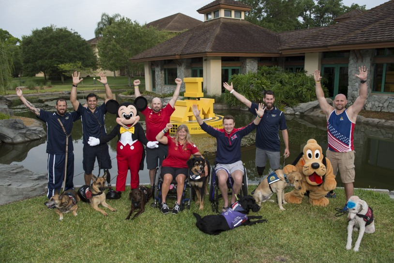 Competitors, their service dogs and Disney's Pluto the Pup gathered at the competitor village. (Photo courtesy Invictus Games Orlando)