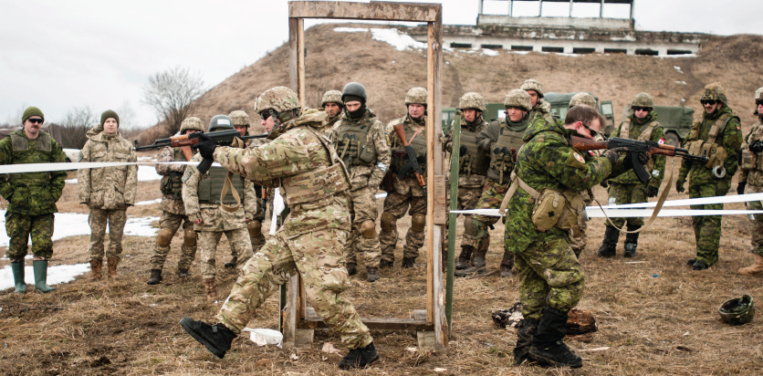 Image Description: Canadian and American combat engineers demonstrate room clearing procedures to Ukrainian soldiers from the 1st Battalion, 28th Mechanized Brigade at the International Peacekeeping and Security Centre in Starychi, Ukraine on February 23, 2017 during Operation UNIFIER. Photo: Sgt. Anthony Jones.