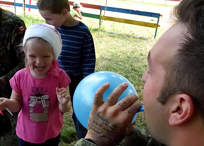Corporal Francis Nadeau amuses the children during a visit of Joint Task Force – Ukraine personnel to the Dzherelo Rehabilitation Centre on July 27, 2016 in Lviv, Ukraine. Photo by : Capt J.P. Coulombe, Joint Task Force – UkraineDC